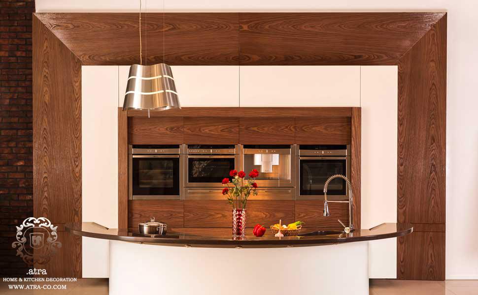 کابینت آشپزخانه مشهد مدل مدرن اکرلیک و چوب گردو کانتر کورین یکپارچه و منحنی، گروه طراحی دکوراسیون داخلی آترا مشهد