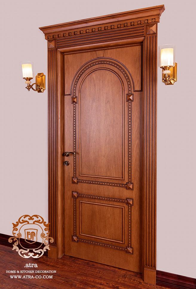 درب چوبی منبت کاری شده از جنس چوب راش، گروه طراحی دکوراسیون داخلی آترا مشهد